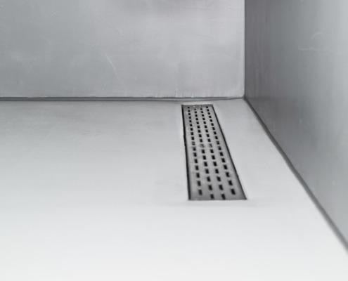 Exclusief stucwerk badkamer in betoncire