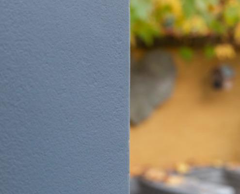 Detailfoto hoek grijs stucwerk buiten