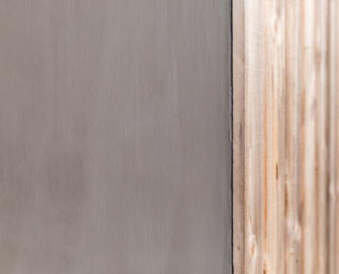 Overkapping met stucwerk en hout